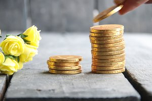 businessman hand holding gold coins and nice flowers