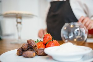 Fresh strawberry and dates on plate