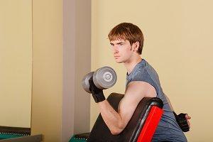 Man exercise biceps