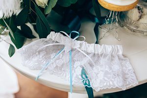 Wedding accessories: Bride's garter and delicate  bow. Closeup