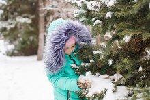 Little girl winter tree.