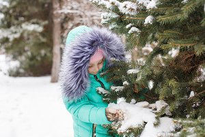 Little girl winter tree.