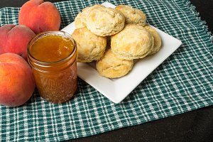 Peach jam and plate of biscuits