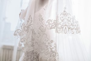 Wedding dress. Unrecognizable, closeup.