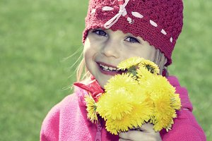 Little girl with yellow flowers