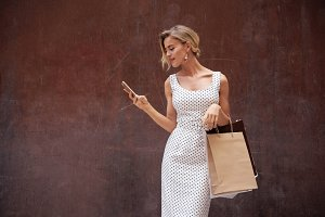 Blonde female with blank paper bags