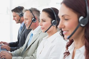 Call center workers wearing headsets