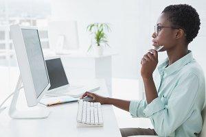 Focused businesswoman working at desk