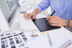 Graphic designer using digitizer at his desk
