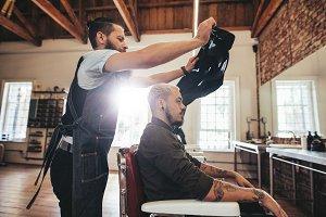 Hairstylist giving hair cute