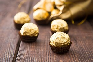 gold bag of chocolates. candy in Golden foil with copy space
