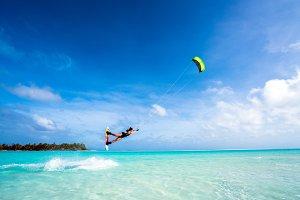 Girl Kitesurfing in Paradise