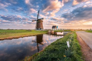 Windmill at sunrise in Netherlands