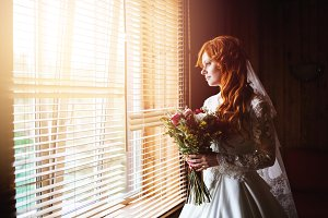 Beautiful red hair bride with flower