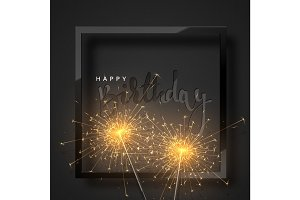 Happy Birthday black lettering with burning sparklers