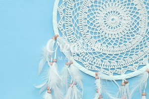 Dreamcatcher on a blue background