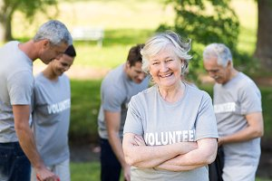 Happy volunteer grandmother smiling at camera