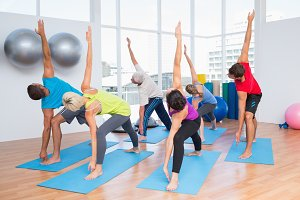 People doing stretching exercise at fitness club