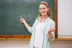Teacher explaining maths in blackboard