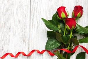 Roses and red  ribbon