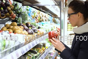 young woman in the store choosing and buying products