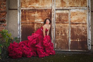 Woman in cloudy red dress, rustic style