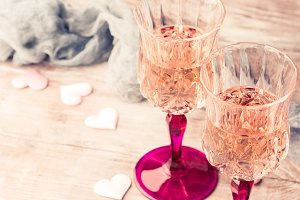 Two pink champagne glasses romantic date toned card