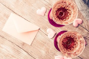 Two pink champagne glasses with blank paper toned card