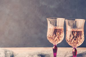 Two pink stemmed glasses with champagne