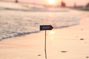 beach sign and sunset, Vacation or holidays idea