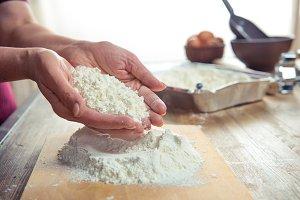Flour in female hand