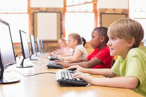 Cute pupils in computer class