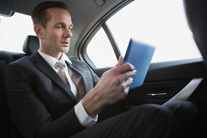 Handsome businessman using his tablet pc