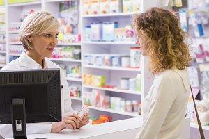 Pharmacist explaining the drug to patient