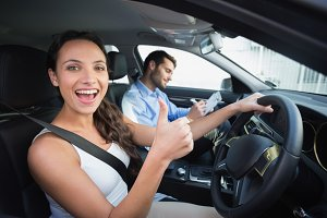 Young woman getting a driving lesson