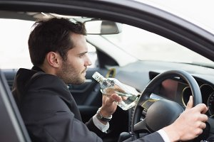 Young businessman driving while drunk