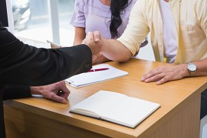 Close up of salesman shaking a customer hand