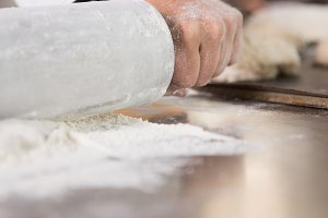 Close up of baker using a rolling pin