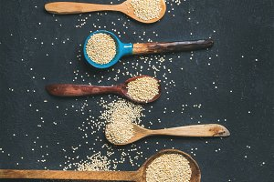 Quinoa seeds in different spoons