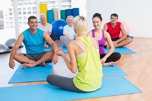 Instructor talking with class in fitness club