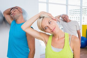 People doing neck exercise in fitness club