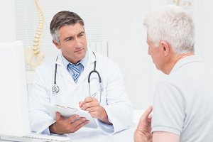 Senior patient sharing problems with doctor