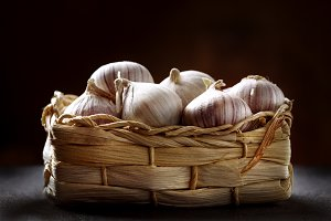 Close-up of basket with garlic