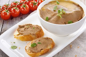 Chicken liver pate on bread and in bowl
