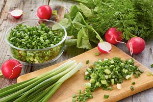 Fresh spring salad ingredients on wooden table