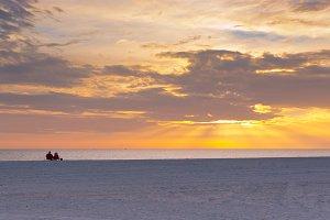 Couple enjoying the ocean sunset