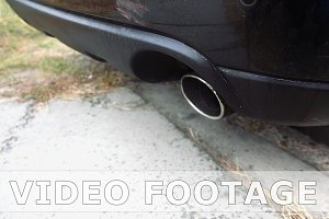Car pipe emitting exhaust gases