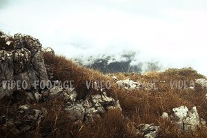 motion along the rocky terrain in autumn misty mountains