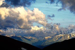 High Snowy Mountains with Clouds Sunset Timelapse. Kavkaz region