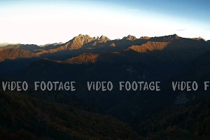 autumn mountains sunrise timelapse. sun illuminates tops